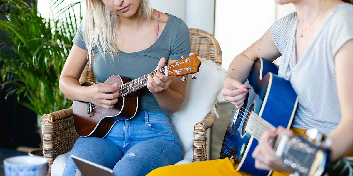 Ladies Playing Ukulele And Guitar