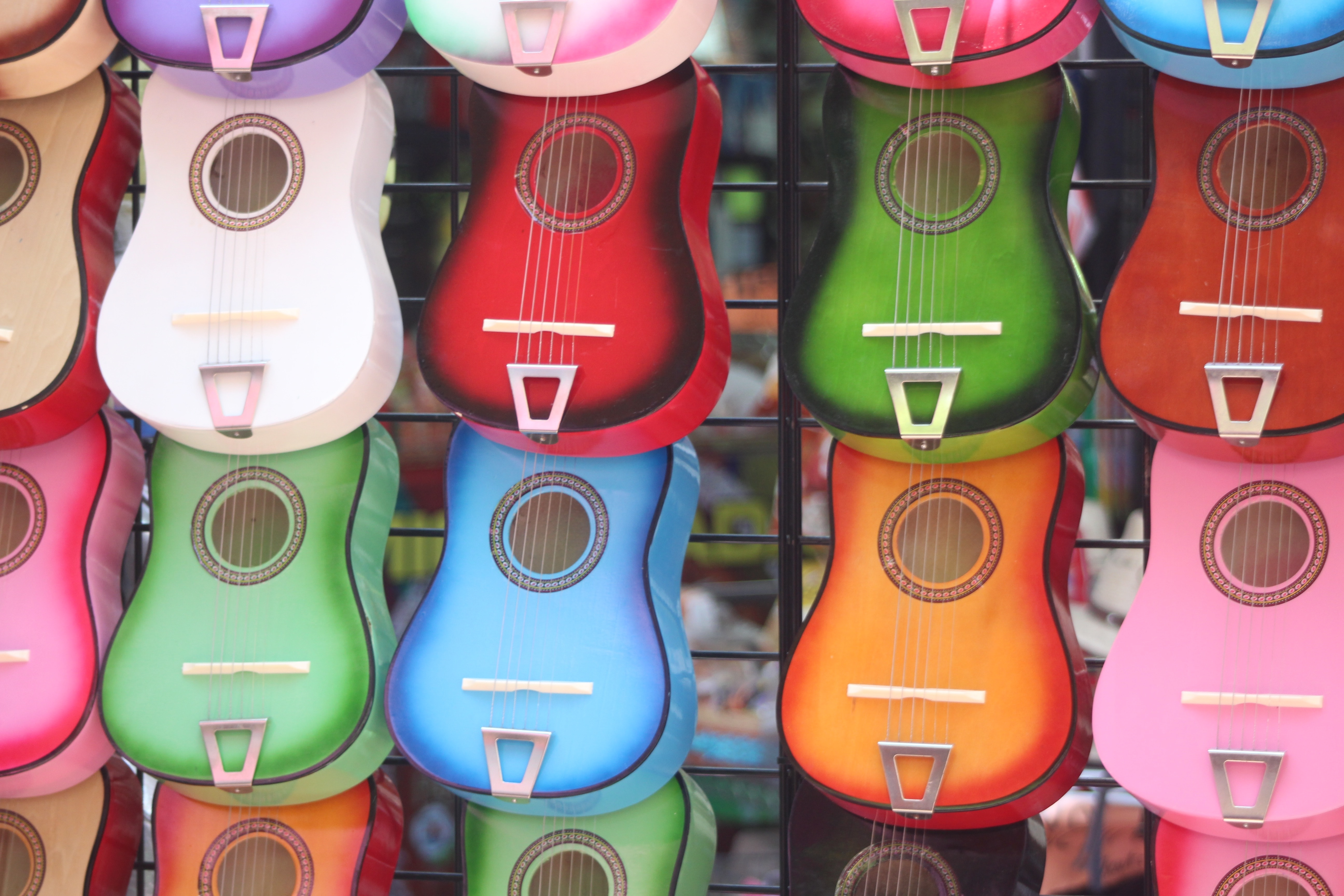 Colorful Acoustic Guitars Hnaging Up