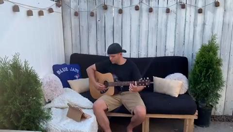 Pat Picante on acoustic guitar
